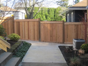 Full Panel Cedar Top Stepped Bottom to Grade Fence