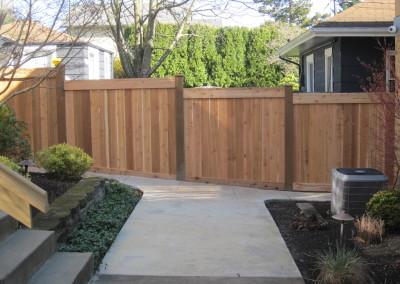Full Panel Cedar Top Stepped Bottom to Grade Fence