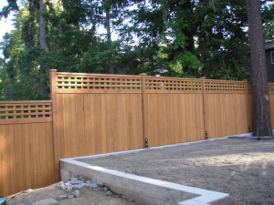 Cedar Fence Stepped attached to Concrete