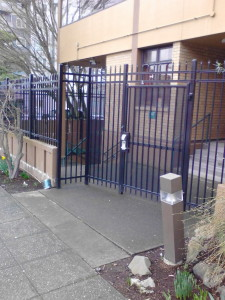 Security Gate with keypad outside building