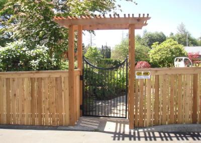 Traditional Cedar Fence with Cedar Arbor and Iron Gate