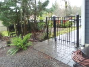 Versa Flat Top Stepped Iron Fence around outdoor restaurant patio