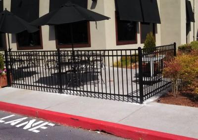 Versa Flat Top Iron Fence around outdoor restaurant patio